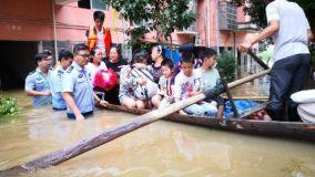 新余:洪水无情袭家园 众志成城越艰险
