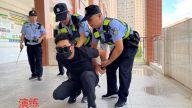 赣州市大坪明德小学:警、校联合演练  共建平安校园